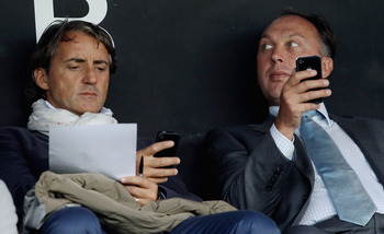 LONDON, ENGLAND - SEPTEMBER 11:  Manchester City manager Roberto Mancini and David Platt watch tfrom the stands during the Barclays Premier League match between Fulham and Blackburn Rovers at Craven Cottage on September 11, 2011 in London, England.  (Phot