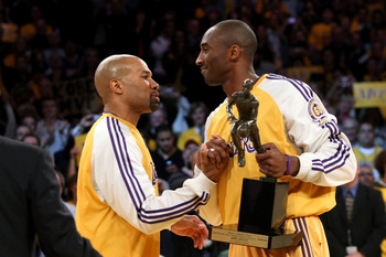 LOS ANGELES, CA - MAY 07:  Derek Fisher #2 congratulates teammate Kobe Bryant #24 of the Los Angeles Lakers after Bryant was presented with the MVP trophy before Game Two of the Western Conference Semifinals against the Utah Jazz during the 2008 NBA Playo