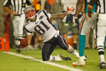 MIAMI GARDENS, FL - SEPTEMBER 12:   Aaron Hernandez #81 of the New England Patriots scores a touchdown during a game against the Miami Dolphins at Sun Life Stadium on September 12, 2011 in Miami Gardens, Florida.  (Photo by Mike Ehrmann/Getty Images)