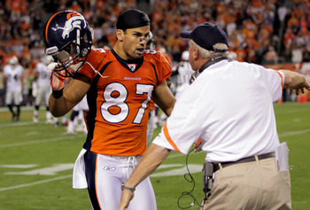 DENVER, CO - SEPTEMBER 12:  Punt returner Eric Decker #87 of the Denver Broncos celebrates with head coach John Fox after Decker returns a punt 90-yards for a touchdown in the third quarter against the Oakland Raiders at Sports Authority Field at Mile Hig