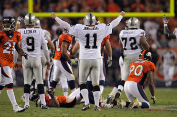 DENVER, CO - SEPTEMBER 12:  Place kicker  Sebastian Janikowski #11 of the Oakland Raiders celebrates his 63 yard field goal with five seconds remaining in the first half to give the Raiders a 16-3 lead over the Denver Broncos at Sports Authority Field at