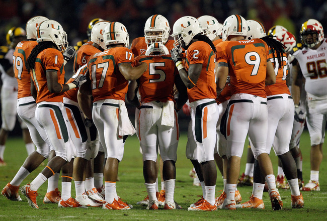 COLLEGE PARK, MD - SEPTEMBER 05: Quarterback Stephen Morris #17 of the Miami Hurricanes calls a play in the huddle against the Maryland Terrapins at Byrd Stadium on September 5, 2011 in College Park, Maryland.  (Photo by Rob Carr/Getty Images)