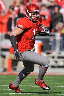 COLUMBUS, OH - NOVEMBER 27:  Jake Stoneburner #11 of the Ohio State Buckeyes runs with the ball against the Michigan Wolverines at Ohio Stadium on November 27, 2010 in Columbus, Ohio.  (Photo by Jamie Sabau/Getty Images)