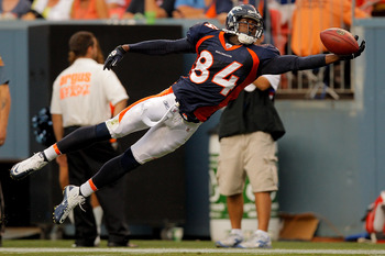 DENVER, CO - AUGUST 20:  Wide receiver Brandon Lloyd #84 of the Denver Broncos lays out but is unable to haul in a pass during the first half against the Buffalo Bills at Sports Authority Field at Mile High on August 20, 2011 in Denver, Colorado. (Photo b