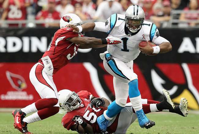GLENDALE, AZ - SEPTEMBER 11:  Quarterback Cam Newton #1 of the Carolina Panthers is sacked by cornerback Richard Marshall #31 of the Arizona Cardinals during the first quarter of the NFL season opening game at the University of Phoenix Stadium on Septembe
