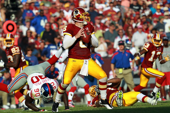 LANDOVER, MD - SEPTEMBER 11:   Rex Grossman #8 of the Washington Redskins drops back to pass against the New York Giants during the season opener at FedExField on September 11, 2011 in Landover, Maryland.  (Photo by Ronald Martinez/Getty Images)