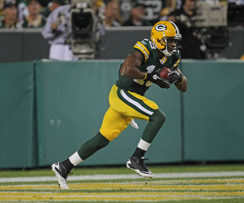 GREEN BAY, WI - SEPTEMBER 08:  Randall Cobb #18 of the Green Bay Packers returns a kick-off 108 yards for a touchdown against the New Orleans Saints during the NFL opening season game at Lambeau Field on September 8, 2011 in Green Bay, Wisconsin. The Pack