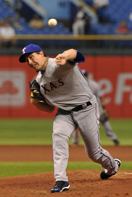 ST. PETERSBURG, FL - SEPTEMBER 07:  Pitcher Derek Holland #45 of the Texas Rangers starts against the Tampa Bay Rays September 7, 2011 at Tropicana Field in St. Petersburg, Florida. (Photo by Al Messerschmidt/Getty Images)