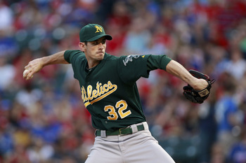 ARLINGTON, TX - SEPTEMBER 9:  Brandon McCarthy #32 of the Oakland Athletics delivers a pitch against the Texas Rangers during the game at Rangers Ballpark in Arlington on September 9, 2011 in Arlington, Texas. (Photo by Rick Yeatts/Getty Images)