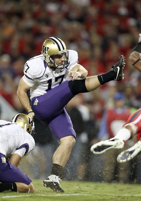 TUCSON, AZ - OCTOBER 23:  Kicker Erik Folk #17 of the Washington Huskies attempts a field goal during the college football game against the Arizona Wildcats at Arizona Stadium on October 23, 2010 in Tucson, Arizona. The Wildcats defeated the Huskies 44-14