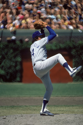 CHICAGO, IL - JUNE 6: Pitcher Fernando Valenzuela #34 of the Los Angeles Dodgers winds up for a pitch against the Chicago Cubs on June 6, 1981 at Wrigley Field in Chicago, Illinois. (Photo by: Jonathan Daniel/Getty Images)