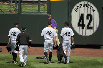 DENVER - APRIL 15:  Relief pitchers for the Colorado Rockies head for the bullpen prior to the game against the New York Mets at Coors Field on April 15, 2010 in Denver, Colorado. All the players in MLB wore #42 today in honor of Jackie Robinson Day. The