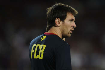 BARCELONA, SPAIN - AUGUST 29:  Lionel Messi of FC Barcelona looks on during teh warm up prior the La Liga match between FC Barcelona and Villarreal CF at Camp Nou on August 29, 2011 in Barcelona, Spain.  (Photo by David Ramos/Getty Images)