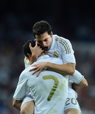 MADRID, SPAIN - SEPTEMBER 10:  Gonzalo Higuain of Real Madrid celebrates with Cristiano Ronaldo after scoring Real's 4th goal during the La Liga match bewteen Real Madrid and Getafe at Estadio Santiago Bernabeu on September 10, 2011 in Madrid, Spain.  (Ph