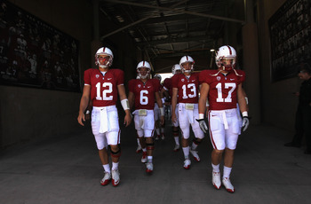 STANFORD, CA - SEPTEMBER 03:  Quarterback Andrew Luck #12 of the Stanford Cardinal leads memebers of his team out for warm ups before their game against the San Jose State Spartans at Stanford Stadium on September 3, 2011 in Stanford, California.  (Photo