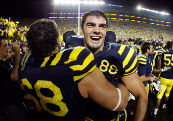 ANN ARBOR, MI - SEPTEMBER 10: Craig Roh #88 of the Michigan Wolverines celebrates a 35-31 over Notre Dame Fighting Irish with Mike Martin #68 at Michigan Stadium on September 10, 2010 in Ann Arbor, Michigan. (Photo by Gregory Shamus/Getty Images)