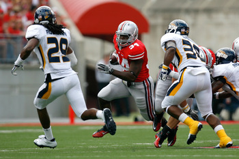 COLUMBUS, OH - SEPTEMBER 10:  Carlos Hyde #34 of the Ohio State Buckeyes runs the ball up field against the Toledo defense during the first half on September 10, 2011 at Ohio Stadium in Columbus, Ohio. Ohio State defeated Toledo 27-22. (Photo by Kirk Irwi