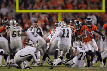 DENVER, CO - SEPTEMBER 12:  Place kicker  Sebastian Janikowski #11 of the Oakland Raiders kicks a 63 yard field goal from the hold of  Shane Lechler #9 of the Oakland Raiders with five seconds remaining in the first half to give the Raiders a 16-3 lead ov