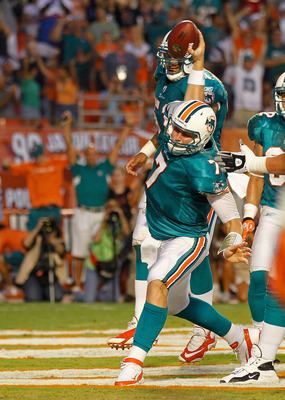 MIAMI GARDENS, FL - SEPTEMBER 12:  Chad Henne #7 of the Miami Dolphins celebrates after he rushes for a touchdown during a game  against the New England Patriots at Sun Life Stadium on September 12, 2011 in Miami Gardens, Florida.  (Photo by Mike Ehrmann/