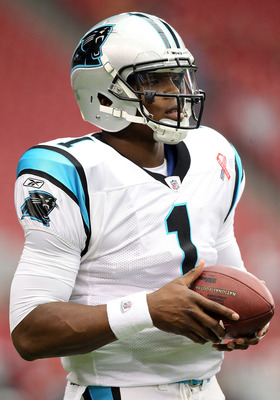 GLENDALE, AZ - SEPTEMBER 11:  Quarterback Cam Newton #1 of the Carolina Panthers warms up before the NFL season opening game against the Arizona Cardinals at the University of Phoenix Stadium on September 11, 2011 in Glendale, Arizona. The Carindals defea