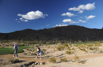 MARANA, AZ - FEBRUARY 23:  Lee Westwood of England and caddie walk on the 16 hole during the first round of the World Golf Championships-Accenture Match Play Championship held at The Ritz-Carlton Golf Club, Dove Mountain on February 23, 2011 in Marana, Ar
