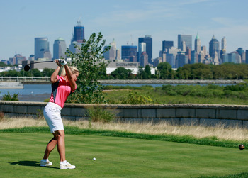 JERSEY CITY, NJ - AUGUST 30:  Suzann Pettersen of Norway hits a shot during the Birdies for Breast Cancer Foundation Liberty Cup at Liberty National Golf Club on August 30, 2011 in Jersey City, New Jersey.  (Photo by Scott Halleran/Getty Images)