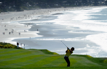 PEBBLE BEACH, CA - FEBRUARY 13:  Hunter Mahan plays his approach shot on the nineth hole during the final round of the AT&T Pebble Beach National Pro-Am at Pebble Beach Golf Links on February 13, 2011  in Pebble Beach, California.  (Photo by Stuart Frankl