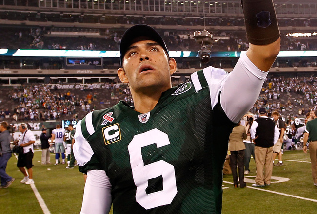 EAST RUTHERFORD, NJ - SEPTEMBER 11:  Mark Sanchez #6 of the New York Jets celebrates after the Jets won 27-24 against the Dallas Cowboys during their NFL Season Opening Game at MetLife Stadium on September 11, 2011 in East Rutherford, New Jersey.  (Photo