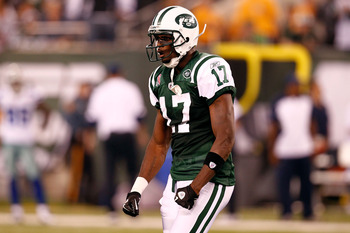 EAST RUTHERFORD, NJ - SEPTEMBER 11:  Plaxico Burress #17 of the New York Jets reacts against the Dallas Cowboys during their NFL Season Opening Game at MetLife Stadium on September 11, 2011 in East Rutherford, New Jersey.  (Photo by Jeff Zelevansky/Getty