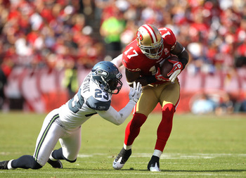 SAN FRANCISCO, CA - SEPTEMBER 11:  Braylon Edwards #17 of the San Francisco 49ers is tackled by Marcus Trufant #23 of the Seattle Seahawks  during their season opener at Candlestick Park on September 11, 2011 in San Francisco, California.  (Photo by Ezra