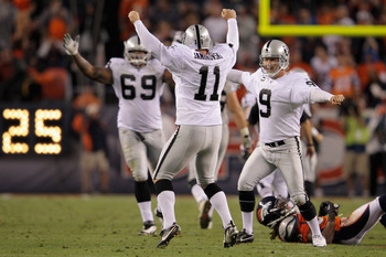 DENVER, CO - SEPTEMBER 12:  Place kicker  Sebastian Janikowski #11 of the Oakland Raiders celebrates his 63 yard field goal with five seconds remaining in the first half with teammates Khalif Barnes #69 of the Raiders and Shane Lechler #9 of the Raiders t