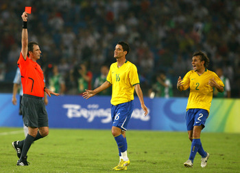 BEIJING - AUGUST 19:  Thiago Neves of Brazil is shown the red card by referee Martin Vasquez as Rafinha of Brazil comes over during the men's football semifinal match at Workers' Stadium on Day 11 of the Beijing 2008 Olympic Games on August 19, 2008 in Be