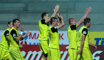 PLZEN, CZECH REPUBLIC - AUGUST 29:  Sparta Praha players celebrate victory after the Czech Gambrinus League match between FC Viktoria Plzen and AC Sparta Praha on August 29, 2011 in Plzen, Czech Republic.  (Photo by Michal Cizek/EuroFootball/Getty Images)