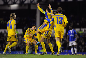 LIVERPOOL, ENGLAND - DECEMBER 17: Aliaksandr Volodko of BATE Borisov celebrates with team mates after scoring the winning goal during the UEFA Europa League Group I match between Everton and BATE Borisov at Goodison Park on December 17, 2009 in Liverpool,