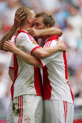 AMSTERDAM, NETHERLANDS - AUGUST 14:  Kolbeinn Sigthorsson (L) and Christian Eriksen of Ajax Amsterdam celebrate a goal during the Eredivisie League match between Ajax Amsterdam and SC Heerenveen held on August 14, 2011 at the Amsterdam ArenA, in Amsterdam
