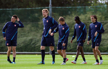 ST ALBANS, ENGLAND - SEPTEMBER 12:  Laurent Koscielny, Per Mertesacker, Andrey Arshavin, Gervinho and Yossi Benayoun of Arsenal warm up during a training session ahead of their UEFA Champions League Group match against Borussia Dortmund at London Colney o