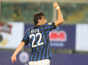 PALERMO, ITALY - SEPTEMBER 11: Diego Milito of Inter celebrates the opening goal during the Serie A match between US Citta di Palermo and FC Internazionale Milano at Stadio Renzo Barbera on September 11, 2011 in Palermo, Italy.  (Photo by Maurizio Lagana/