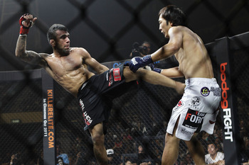 SINGAPORE - SEPTEMBER 03:  (L-R) Leandro Issa kicks Soo Chui Kim during the ONE Fighting Championships bantamweight bout at Singapore Indoor Stadium on September 3, 2011 in Singapore.  (Photo by Suhaimi Abdullah/Getty Images)