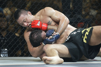 SINGAPORE - SEPTEMBER 03: Phil Baroni  (bottom) defends himself against Yoshiyuki Yoshida (top) during the ONE Fighting Championships welterweight bout  at Singapore Indoor Stadium on September 3, 2011 in Singapore.  (Photo by Suhaimi Abdullah/Getty Image