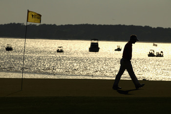 HILTON HEAD ISLAND, SC - APRIL 23:  Luke Donald of England walks off the 18th green during the third round of The Heritage at Harbour Town Golf Links on April 23, 2011 in Hilton Head Island, South Carolina.  (Photo by Streeter Lecka/Getty Images)