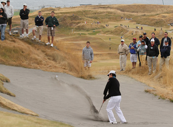 UNIVERSITY PLACE, WA - AUGUST 29:  David Chung hits out of the bunker on No. 4 on the final day of the U.S. Amateur Golf Championship on August 29, 2010 at Chambers Bay in University Place, Washington. Peter Uihlein won the 36 hole final 4 and 2. (Photo b