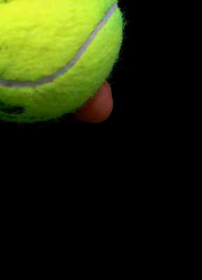 NEW YORK, NY - SEPTEMBER 11:  A ball person holds tennis balls during Day Fourteen of the 2011 US Open at the USTA Billie Jean King National Tennis Center on September 11, 2011 in the Flushing neighborhood of the Queens borough of New York City.  (Photo b