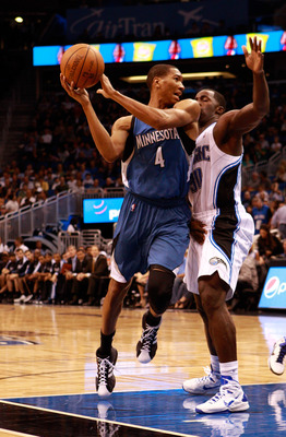 ORLANDO, FL - NOVEMBER 03:  Wesley Johnson #4 of the Minnesota Timberwolves attempts to pass against Brandon Bass #30 of the Orlando Magic during the game at Amway Arena on November 3, 2010 in Orlando, Florida.  NOTE TO USER: User expressly acknowledges a