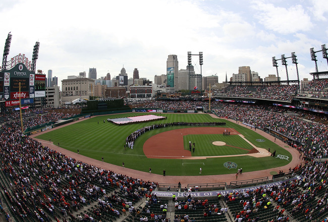 DETROIT, MI - SEPTEMBER 11:  The Detroit Tigers and the Minnesota Twins take the field along with members of the local Fire and Police Departments marking the commemorate, 'National Day of Service and Remembrance' of the 10th anniversary of September 11th