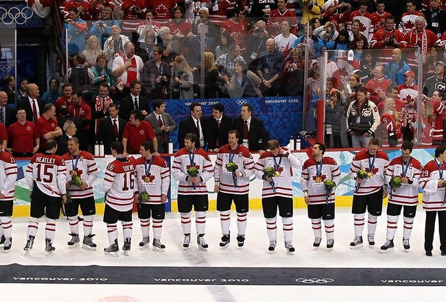 VANCOUVER, BC - FEBRUARY 28:  Team Canada stand and wait for the playing of the Canadian National Anthem after receiving their gold medals for winning the ice hockey men's gold medal game between USA and Canada on day 17 of the Vancouver 2010 Winter Olymp
