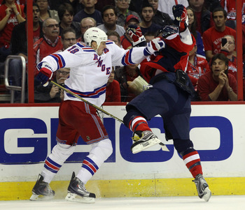 WASHINGTON, DC - APRIL 13:  Marc Staal #18 of the New York Rangers stops Alex Ovechkin #8 of the Washington Capitals  in Game One of the Eastern Conference Quarterfinals during the 2011 NHL Stanley Cup Playoffs at Verizon Center on April 13, 2011 in Washi