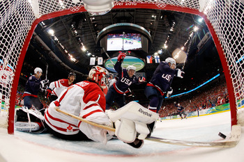 VANCOUVER, BC - FEBRUARY 28:  Zach Parise #9 of the United States celebrates after scoring a goal past Roberto Luongo #1 of Canada to tie the scores 2-2 late in the third during the ice hockey men's gold medal game between USA and Canada on day 17 of the