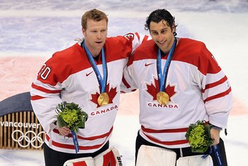 VANCOUVER, BC - FEBRUARY 28:  (L-R) Goaltenders Martin Brodeur #30 and Roberto Luongo #1 of Canada pose for a photo after receiving their gold medals for winning the ice hockey men's gold medal game between USA and Canada on day 17 of the Vancouver 2010 W