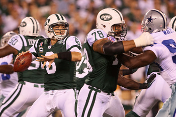 EAST RUTHERFORD, NJ - SEPTEMBER 11:  Mark Sanchez #6 of the New York Jets throws a pass against the Dallas Cowboys in the first half during their NFL Season Opening Game at MetLife Stadium on September 11, 2011 in East Rutherford, New Jersey.  (Photo by E