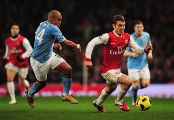 LONDON, ENGLAND - JANUARY 05:  Jack Wilshere of Arsenal evades Nigel de Jong of Manchester City during the Barclays Premier League match between Arsenal and Manchester City at the Emirates Stadium on January 5, 2011 in London, England.  (Photo by Shaun Bo